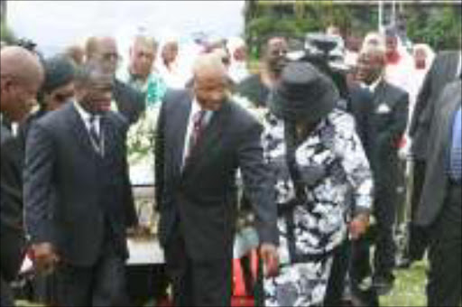 LIFE WELL LIVED: At the funeral of Adelaide Tambo at the Wattville Stadium hundreds of people came to pay their respects. Members of the ANC executive carried her coffin to the hearse. Pic. Mbuzeni Zulu. 11/02/07. © Sowetan.