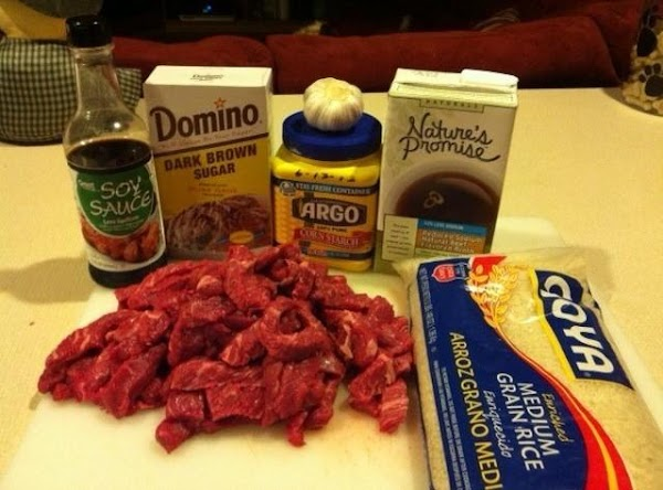 Place beef in a crock pot.  In a small bowl, combine consumme, soy sauce,brown sugar/honey,...