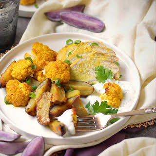 Curried Sheet Pan Pork Tenderloin with Potatoes and Cauliflower.