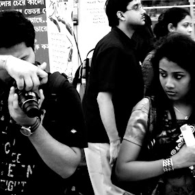 Attention Please by Storyteller Shantanu - People Portraits of Women ( photographers, look, gazeblack and white, kolkata, camera, india, women, fair, book fair )