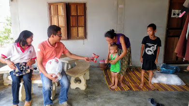 Photo: Mae Ai: House visit with Wi and volunteer healthcare worker Daeng.