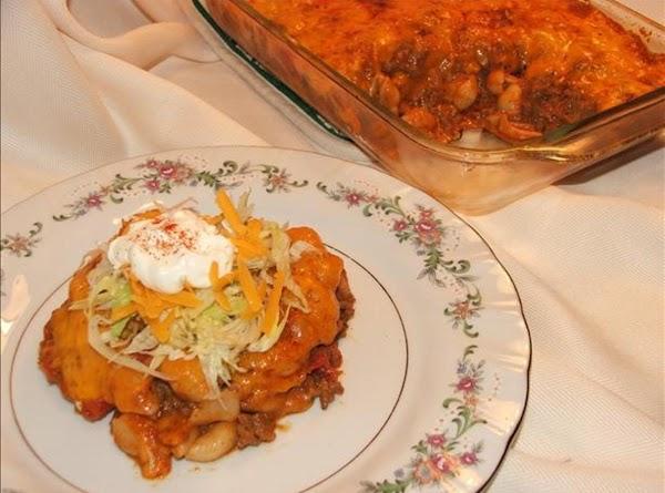 In deep frying pan, cook beef (lightly seasoned with salt, pepper, garlic powder, chili...