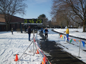Photo: EORC member and Boston qualifier Jean Henneberry finishes the 10K