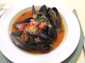 Photo: Clam or mussels with bacon and tomato