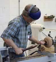 Photo: David makes chips fly as he shows how to begin hollowing this vessel with a bowl gouge...