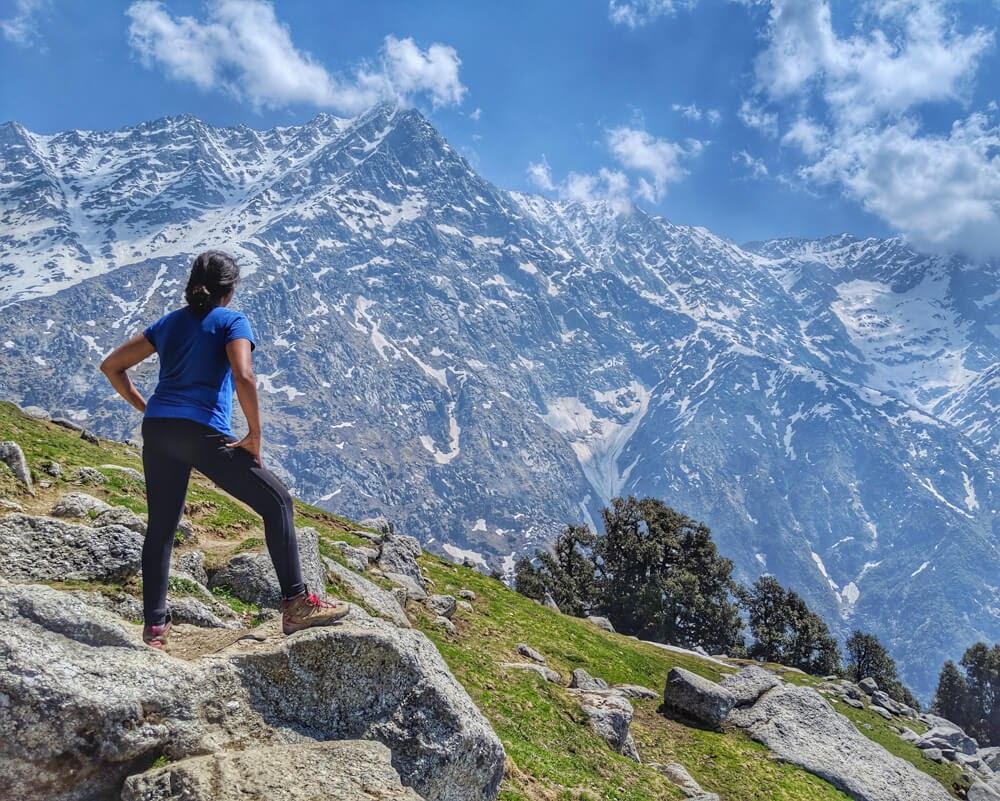 girl+standing+top+triund+successful