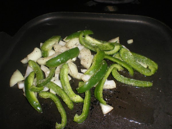 In a small bowl combine peppers and onions.  Drizzle with oil and then...