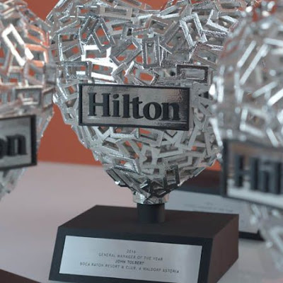 3d printing gallery image of a chrome plated resin trophy in the shape of a heart used at a hilton corporate event gala