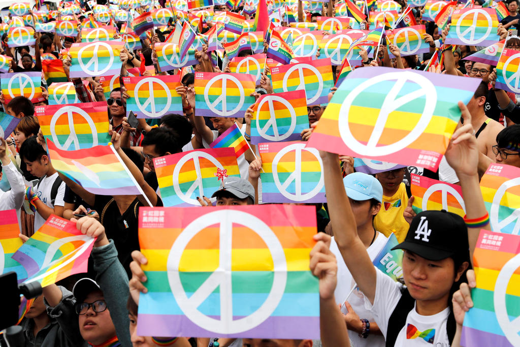 Same-sex marriage supporters take part in a LGBT pride parade after losing in the marriage equality referendum, in Kaohsiung