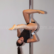 Photo: Vertical Pole Gymnastics - Bow with No Handed Shelf Extension