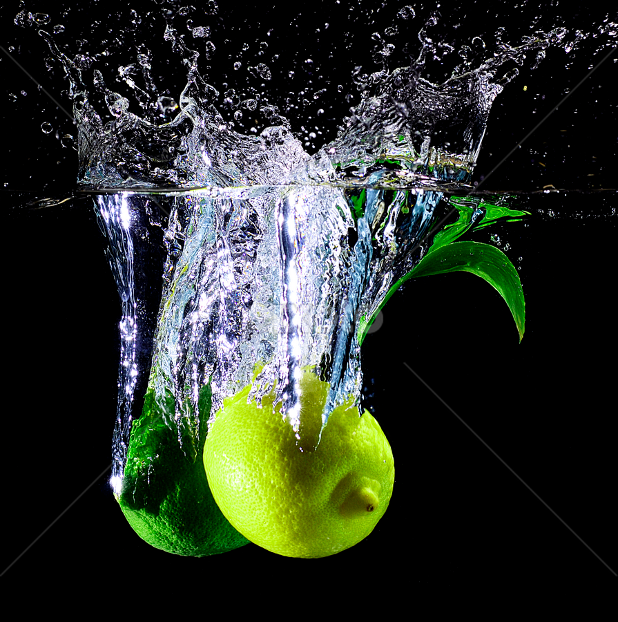 we're opposite.. by Pete G. Flores - Food & Drink Fruits & Vegetables ( clear, sparkling, fruits studio, leaf lemon foods vegetables yellow green drop otep autofocus, splash water )