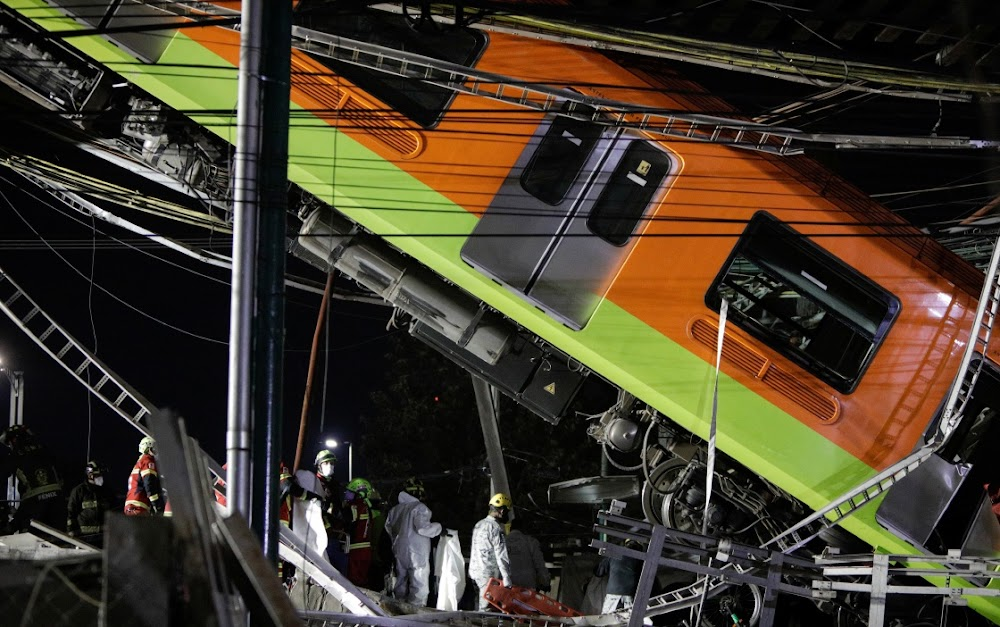 Mexico City rail overpass collapses onto road, killing 20 people