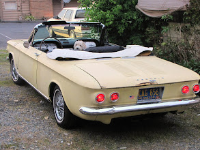 Photo: I bought a used boot cover for $20 - I't not for an EM Corvair, thats for sure! Only a couple of the snaps are in the right place.  Sure looks sweet with the top down and Mr. Preston riding shotgun.  I really like the look of the dual tail-lights.