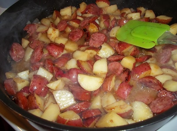 Combine the brown sugar, vinegar, mustard, thyme and pepper; stir into skillet. Bring to...