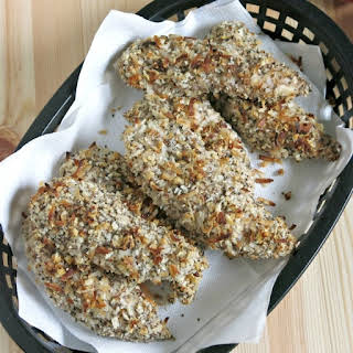 Oven Baked Chicken Tenders with Coconut and Pecans.