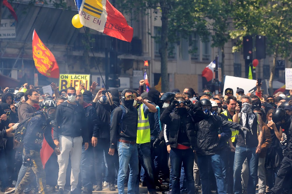 French police fire tear gas at protesters in Paris May Day rally