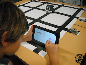 Photo: Kid programming Infante Robot with tablet