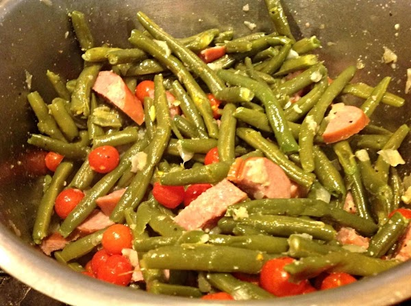 Allow to simmer over low heat about 5-8 minutes, just until sausage is heated...
