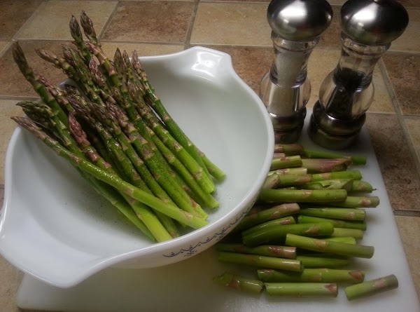 Once your asparagus stems are rinsed, bend the bottoms individually until they each snap....
