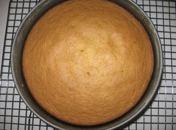 Remove cake layers from oven and allow cake to remain in pan as you...
