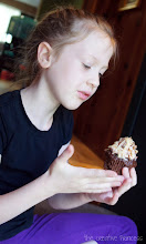 Photo: She thought the cupcake was pretty but was not sure about eating it.