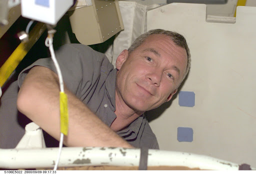 Commander Wilcutt at work aboard Atlantis during STS-106