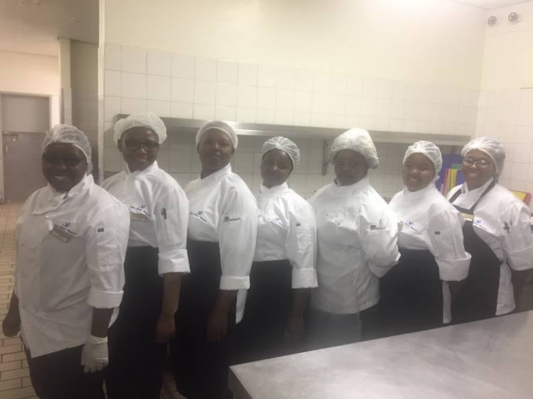 SECURING A FUTURE: Proud participants on the hospitality training course.