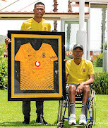 Wiseman Meyiwa, in wheelchair, with  teammate Siyabonga Ngezana.