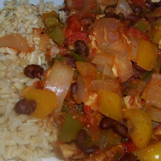 Warm and Spicy Creole Seasoned Chicken and Peppers Over Brown Rice