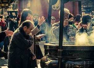 Photo: People wave ritual smoke onto themselves at Sensoji Temple in Asakusa