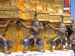 Photo: Giants and Hanuman (monkey god) hold up a golden chedi (stupa) in Wat Phra Kaew.