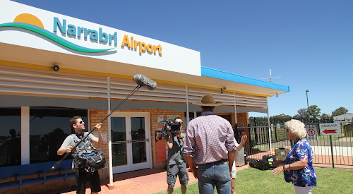 Cameraman Benny Wuyts, sound recordist Yannile Bolsens and mayor Cathy Redding at Narrabri airport yesterday morning as the 'farmer', back to camera, is interviewed by host, popular Belgian TV and radio presenter An Lemmens, also obscured.