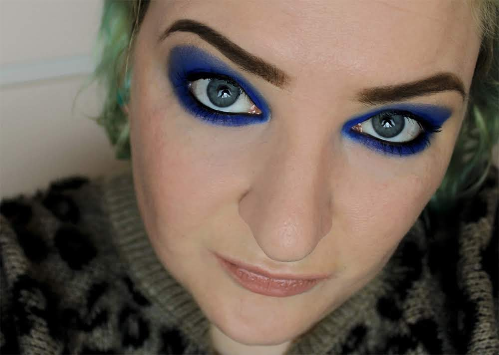 blue eyeshadow on blue eyes glam strong makeup