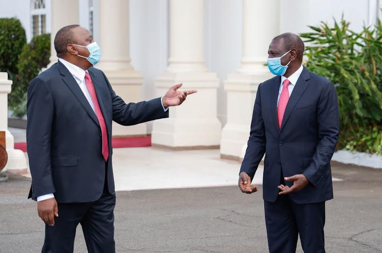 President Uhuru Kenyatta greets Deputy President Dr. William Ruto shortly before the 57th Madaraka Day Celebrations at State House, Nairobi.