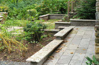 Photo: Sloping this path up to the back door made the house accessible. Using natural stone made it classy.