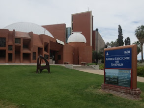 Photo: The Flandrau planetarium at the University of Arizona at Tucson. Look closely at the top of the artwork structure on the lawn... that's a huge iron meteorite!! :)