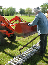 Photo: Norman Beveridge hooking up the dual chain used to carry concrete track panels.   HALS Work Day 2013-1005 RPW