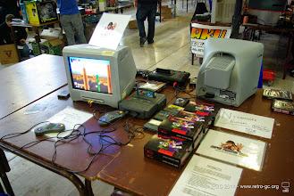Photo: .Stand de Brandon Cobb avec vente d'exemplaires de Nightmare Buster. La console à gauche est une Super A'Can