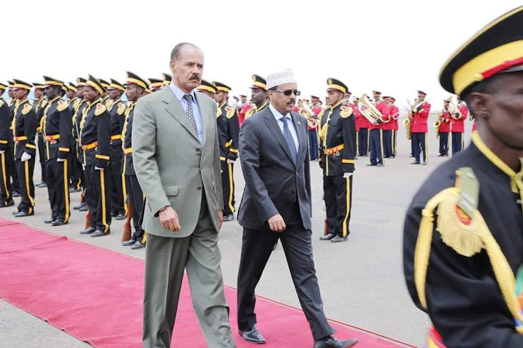 Eritrea's president Isaias Afwerki (L) walks besides Somali president Mohamed Abdullahi Mohamed during a welcoming ceremony upon the latter's arrival in Asmara for a three-day visit on Saturday.