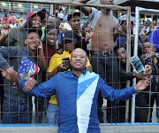 Kaizer Chiefs supporters should give the team a chance, the writer says.