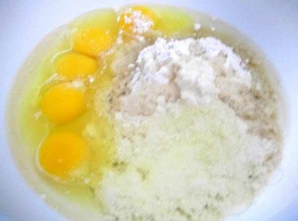 In a large bowl, mix Bisquick, eggs and oil.