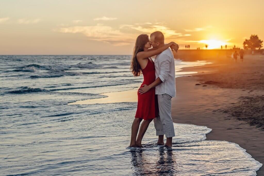 couples enjoying honeymoon on beach