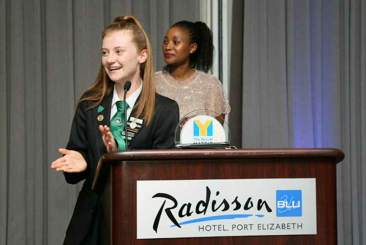 An astounded Abigail Sieberhagen of Pearson High School shares a few words at the gala awards ceremony at the Radisson Blu Hotel last year, as she receives her The Herald Matric of the Year 2017 award. Behind her is The Herald editor Nwabisa Makunga, who was then deputy editor.