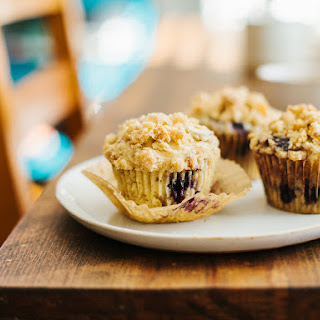 BLUEBERRY MUFFINS WITH ALMOND CRUMB TOPPING.