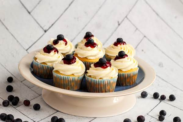 A Plate Of Bursting Blueberry Cupcakes.