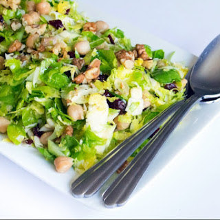 Crunchy Brussels Sprouts and Chickpea Salad with Cranberries and Walnuts