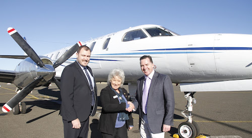 The mayor Cathy Redding and general manager Stewart Todd welcomed Fly Corporate marketing manager Geoff Woodham, right, at the announcement at Narrabri Airport this morning of the launch of the Fly Corporate Sydney air service.