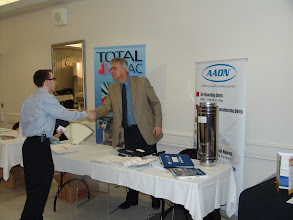 Photo: Adam Beales at the Total HVAC desk