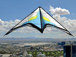 Photo: This is a composite of a photo taken from the Stratosphere about 900 feet up, and a photo of the kite taken in my backyard. The background has had a gradient blur added to make the shot a bit more believable.