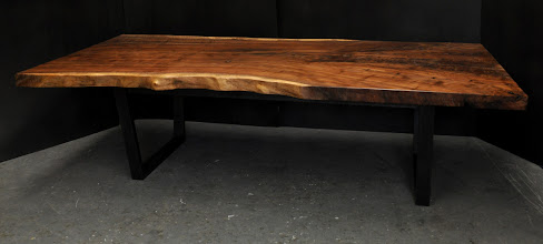 Photo: http://dorsetcustomfurniture.blogspot.com/2012/11/and-now-couple-more-claro-walnut-tables.html